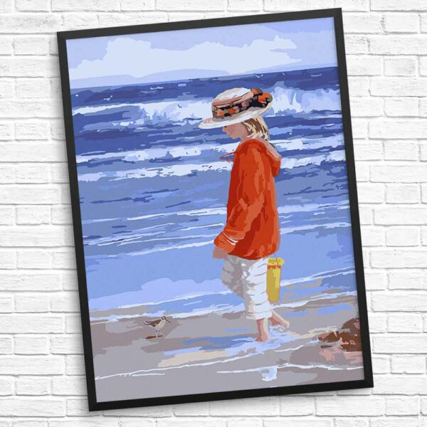 Am Strand spielendes Kind